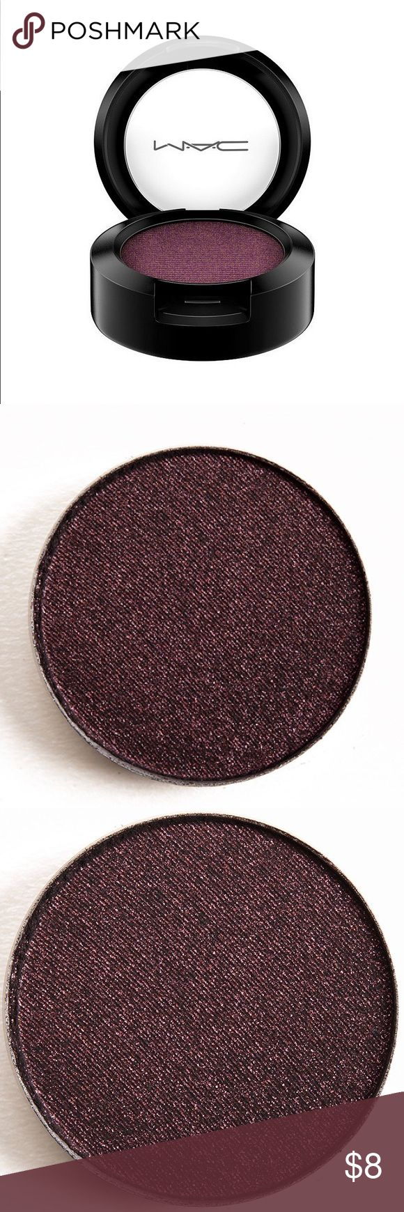 MAC Beauty Marked Eyeshadow MAC Beauty Marked Eyeshadow is described as a black-red sparkle pearl with a velvet finish.   It's a blackened-burgundy with flecks of plum and ruby sparkle and shimmer.  Only swatched once. You can't even really tell that it's been touched at all. MAC Cosmetics Makeup Eyeshadow