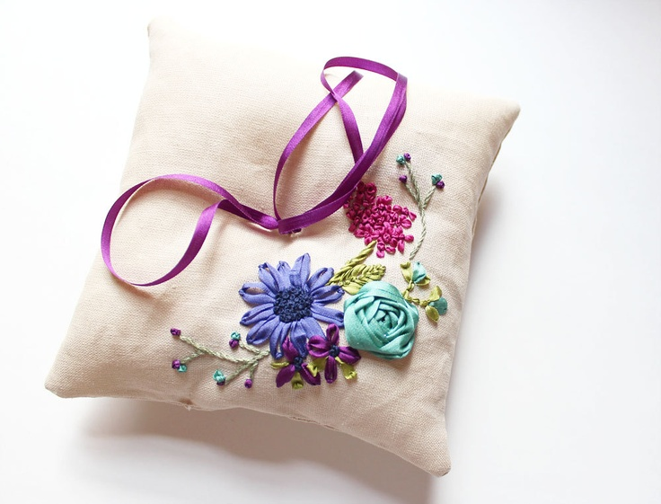 SAMPLE SALE: Ring pillow with ribbon embroidered flowers in teal, purple, and magenta. $65.00, via Etsy.