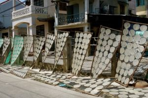 Authentic recipes with rice paper. Photo: drying rice paper on the street in front of a family rice paper factory (source: my personnal food and travel blog / vlog with recipes, authentic video recipes, street food, food and travel documentary, travel info and more. Welcome! :) )