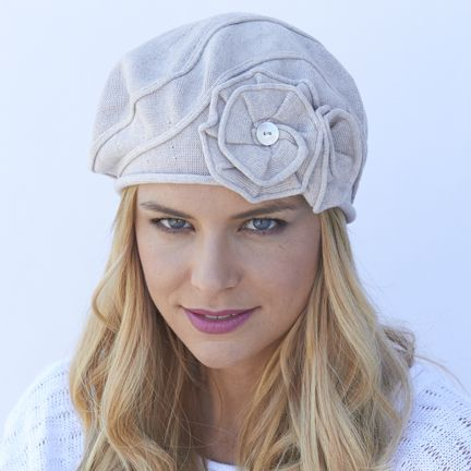 Darling Dahlia Beret. OMG, is this the most darling little beret you've ever seen? We've taken our classic French beret and added a double flower accent and a swirl detail for shape and pizazz.  Full coverage, no inside seams, 100% soft, breathable cotton make this a wonderful hat for cancer patients and women with medical hair loss. 100% cotton. Made in Canada by Parkhurst Hats.