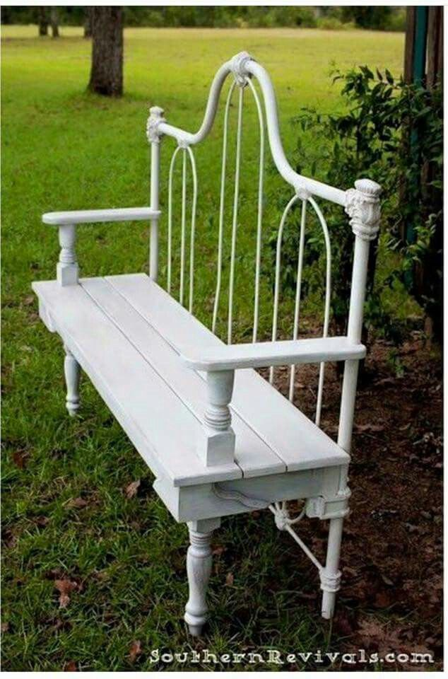 Garden bench with old, iron headboard