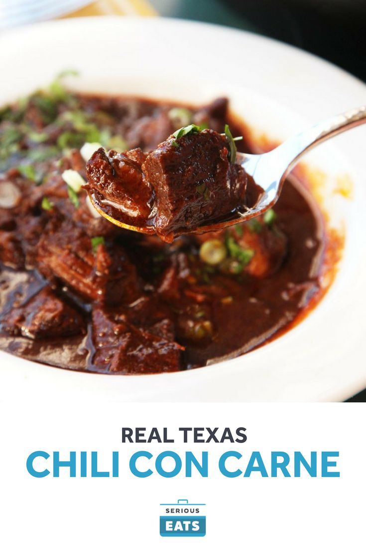 Real Texas chile con carne is made with beef, chilies, and not a whole lot else. This is the real deal. A bowl of hot Texas red with chunky, fall-apart tender beef chuck and fresh dried chilies.