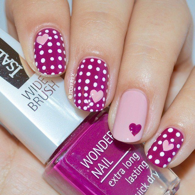 … Or you could go for polka dots AND hearts! The variations in this nail art l…
