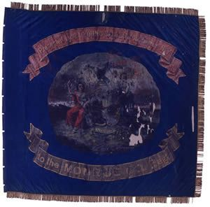 """140th Regiment, NY Volunteer Infantry Regimental flag. In September 1862 the 140th Regiment NY Volunteer Infantry received this painted silk regimental color from a group of young ladies from Rochester. The front side, seen here, features the arms of the State of New York with presentation inscription. The side opposite includes a stylized arms of the United States, the patriotic slogan, """"GOD HELP THE RIGHT,"""" and the regiment's designation."""
