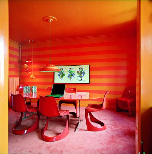 "DigsDigs posted this photo: ""Super Modern Bright Red & Orange Dining Area. 39 Bright & colorful Dining room Design Ideas. Here it is the 290 chair in Red designed by Steen Ostergaard around a red dining table, walls are striped red and orange."