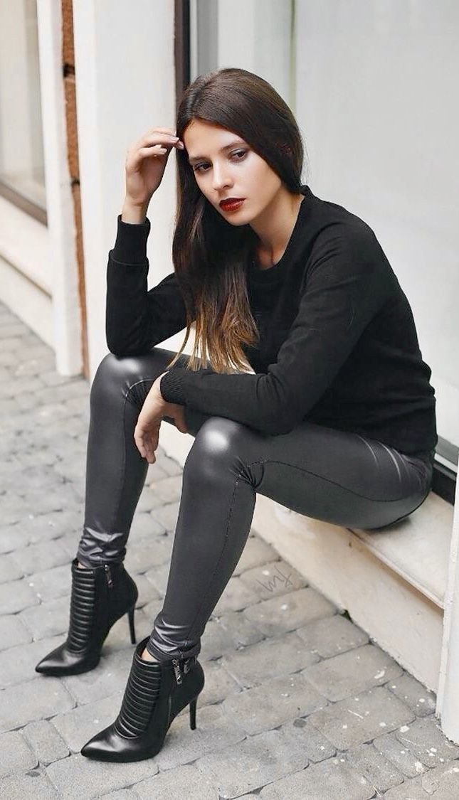 Cute Girl in superb black faux Leather Leggings and stylish