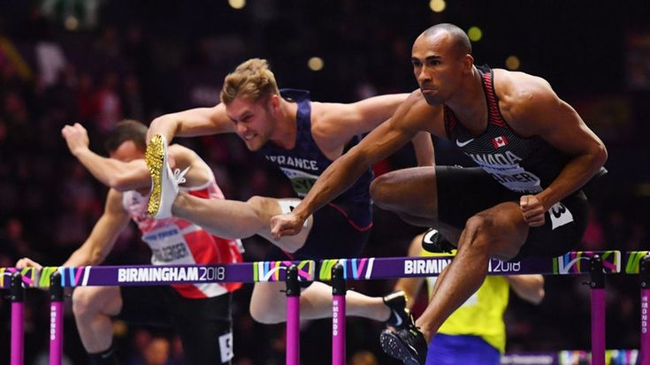 Damian Warner sets Canadian heptathlon record to capture silver at world indoor track championships | CBC Sports. 28-year-old establishes 4 personal bests en route to podium finish. France's Kevin Mayer, centre, and Canada's Damian Warner, right, compete in the men's 60m hurdles heptathlon event at the World Indoor Track and Field Championships. Warner would end up winning silver. Mar 3, 2018
