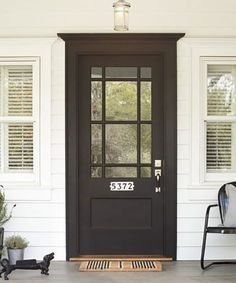 Make bright-white porcelain-tile house numbers, (about $75; @Rejuvenation), pop for mail carriers and visitors alike with a stark, sophisticated black-painted front door.