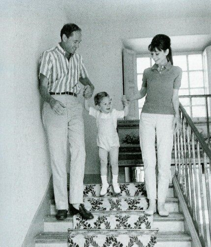 "The actress Audrey Hepburn photographed with her husband Mel Ferrer (actor, dialogue coach and film director) and their son Sean H. Ferrer by Pierluigi Praturlon at ""Villa Bethania"", their charming villa in Bürgenstock (Switzerland), in June 1962.Audrey was wearing:Polo shirt: Lacoste (of cotton pique in a shade of brown, purchased by Audrey in 1962)."
