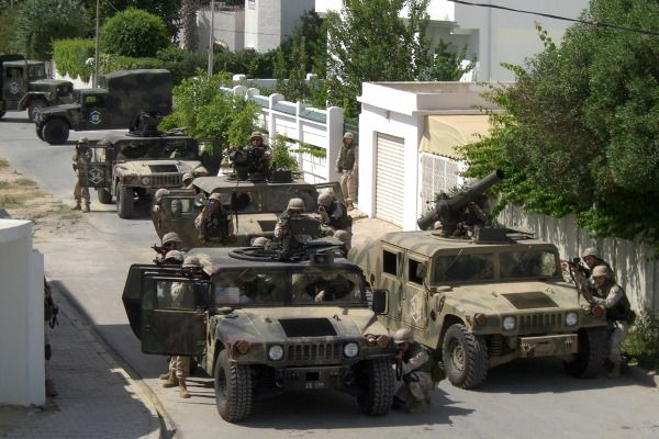 """Troops of the US Army 101st Airborne division surrounding Uday and Qusay Hussein's hideout - """"House of Saddam"""" (2008)"""