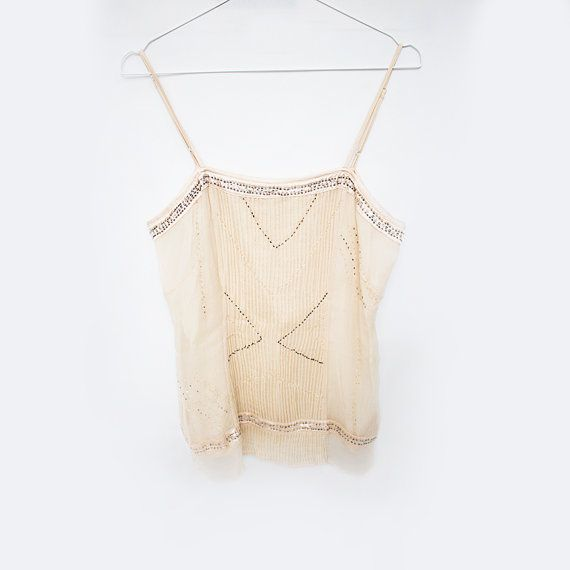 Delicate Layered Vintage Sequin Top   features: layered top concealed zipper on the side color-gold/creme embellished with beads and sequins