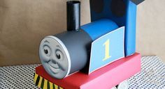 Thomas Oatmeal Canister Train - http://www.pbs.org/parents/birthday-parties/thomas-birthday-party/decorations/thomas-oatmeal-canister-train/