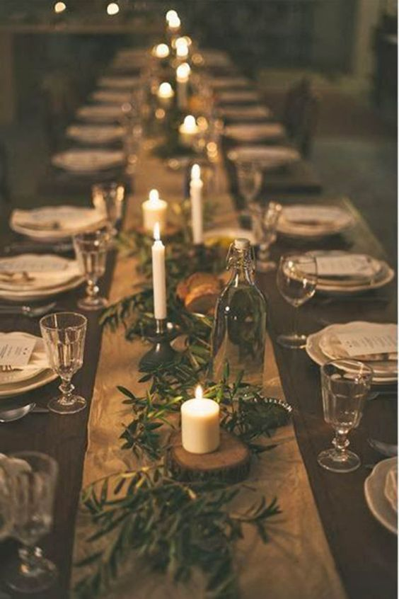 Stick to your roots. Use live Christmas tree branches over your table runner to bring a little bit of the wilderness to your tablescape.