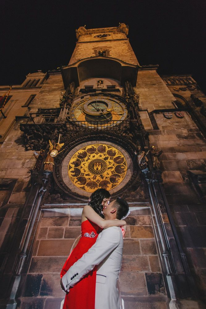 Suki & Steven's beautiful pre wedding portraits at Prague's famous Astronomical Clock by American Photographer Kurt Vinion