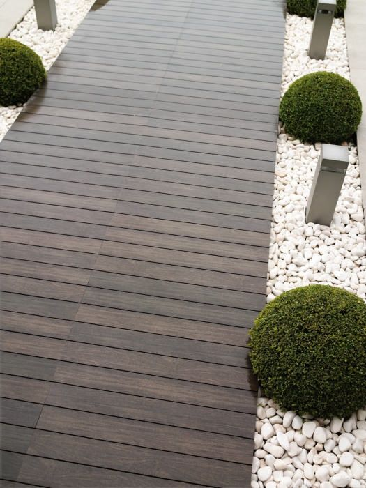 Outdoor Rossetto Wall and Floor Timber Look Tiles- use pier pile-ons with lights on top for nautical accent.