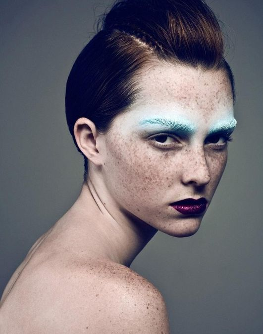 Check out these bright blue brows and deep burgundy lips.