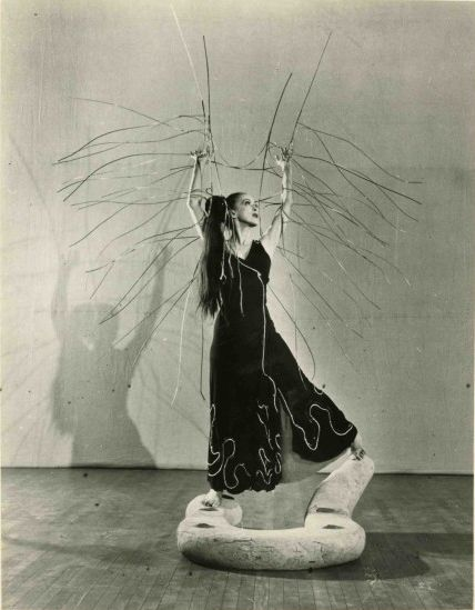 """Uncredited Photographer   Martha Graham on Isamu Noguchi's Sculpture/Set Piece for Graham's Dance """"Cave of the Heart,"""" New York City   1946"""