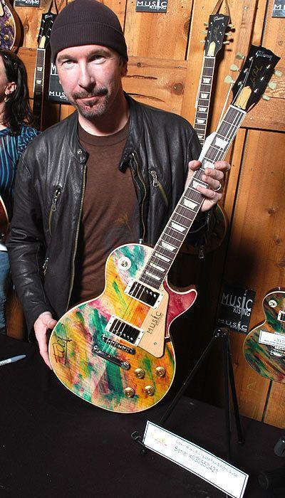 The Edge with his Custom Music Rising Les Paul