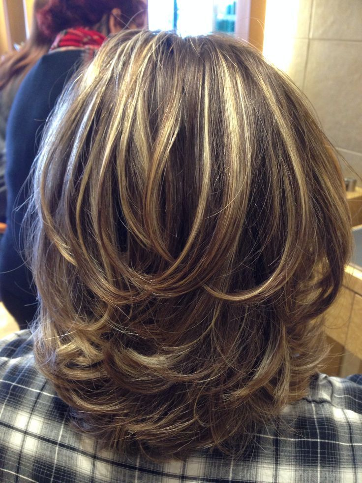 Layered hair cut with dimensional color