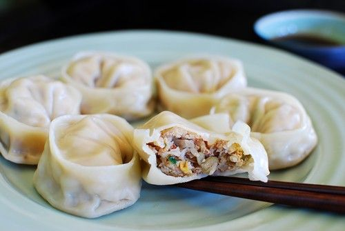 Steamed Mandu (Korean Dumplings) RECIPE: with kimchi, tofu, sprouts, onion, scallions, pork, garlic, ginger. Dipping Sauce: 1 tablespoon soy sauce 1 teaspoon vinegar 1 tablespoon water 1/2 teaspoon sugar pinch of black pepper pinch of red pepper flakes (gochugaru)