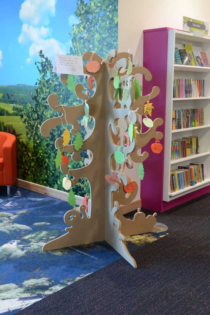 Writing tree from Opening the Book Furniture invites children to write what they think of their new library.