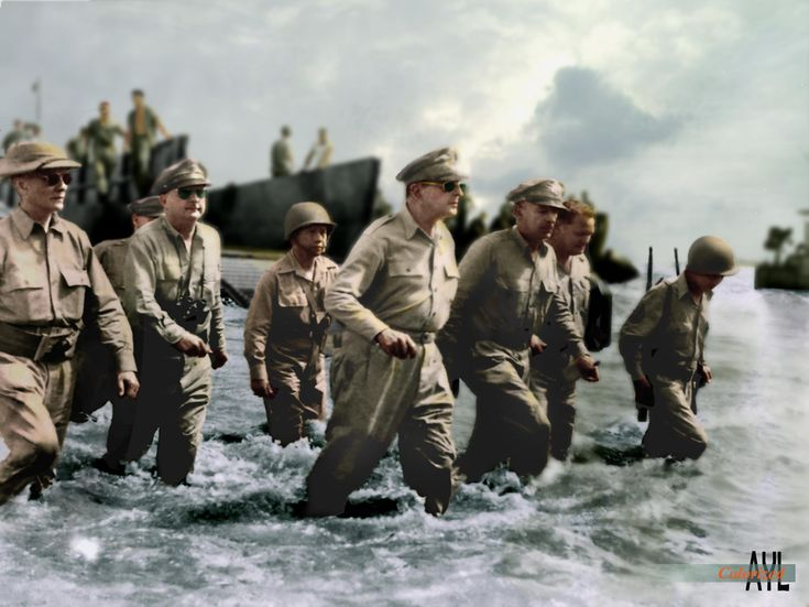 Gen. MacArthur in a publicity still on his Leyte landing to liberate the Philippines from Japanese occupation Oct 1944