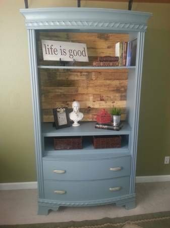 Beautiful Armoire repurposed as open bookcase with pallet wood back.