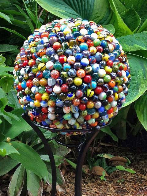DIY garden globe - These marble garden globes are the genius design of Etsy shop 'Ta Dah PDX'. If you are patient, you could DIY this with some E-6000 adhesive, an old thrift store bowling ball, marbles, and a lot of time. Or,  you could do it the easy way, and contact Ta Dah PDX!