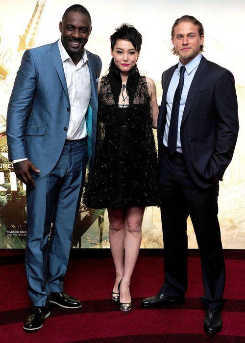 charlie hunnam with Idris Elba and Rinko Kikuchi.