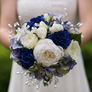 """Blue Jasmine"" Bridal Bouquet featuring cream roses and royal blue carnations"