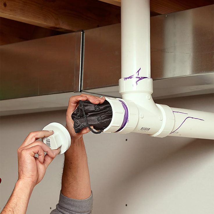 Put in a fake PVC pipe complete with a cleanout plug somewhere in your basement or utility room. Unscrew the plug and there are the goods.