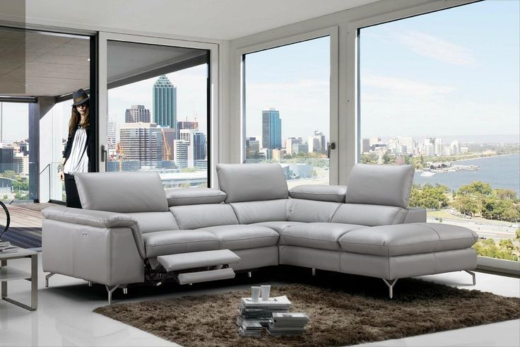Silver grey spacious Italian leather sectional sofa. We are very excited to offer our customers another options with a power recliner. This sectional sofa is the perfect addition to any contemporary home decor. This sectional sofa set features durable solid oak frame and Italian leather, which boast...