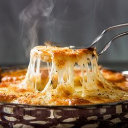 Skillet Scalloped Potatoes. Lots of Gruyere cheese!!