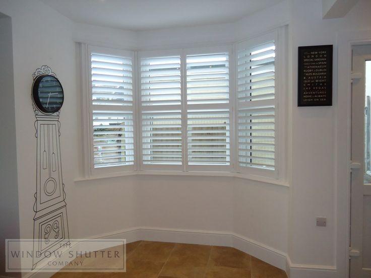 Short Window Shutters Bay Window And Corner Fireplace
