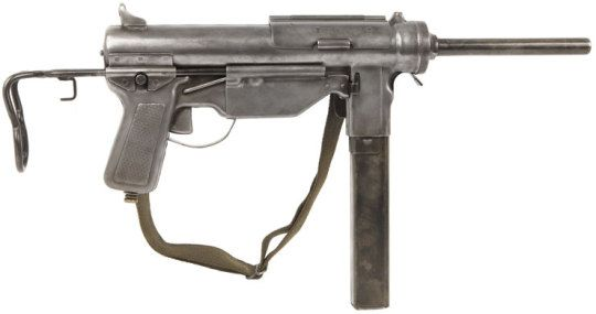 "M3A1 ""Grease Gun"" submachine gun  Designed by George Hyde c.1942 and manufactured by Guide Lamp - General Motors - c.1943~50′s. .45ACP 30-round magazine, open bolt blowback full automatic, stamped sheet metal construction, hinged bolt dust cover. Designed to replace the Thompson submachine guns as a cheaper alternative, it failed to enter a big enough production rate to achieve that. It still remained in service until the 1990′s as a vehicle crew weapon."