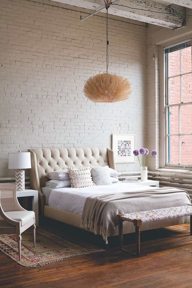 master bedroom white brick wall as accent wall ivory tufted headboard and rust coloured persian rug side tables brass and glass west elm - Decorating Bedroom