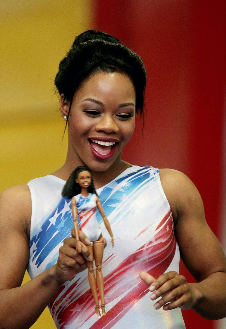 Gabby Douglas holds her Barbie doll