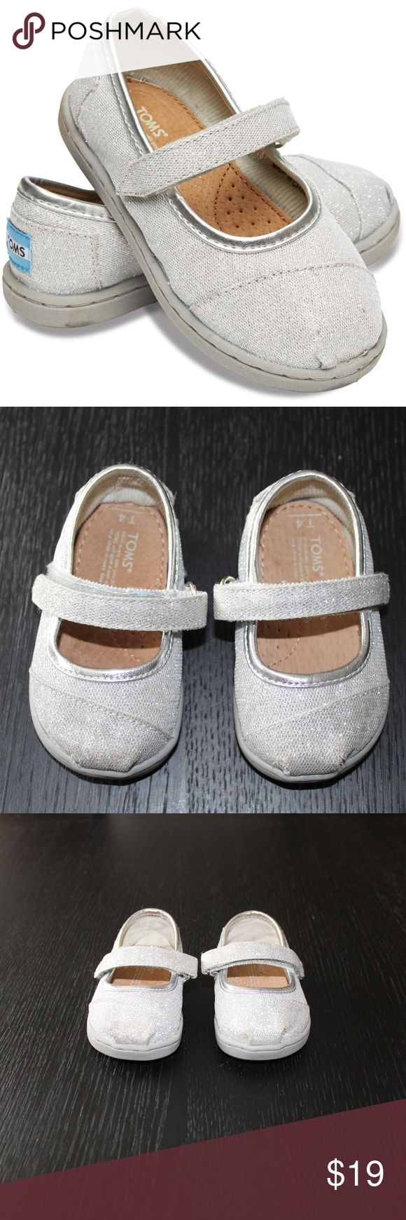 SILVER GLIMMER TINY TOMS MARY JANES Lightly worn 4T Toms Silver glimmer tiny tom shoes.   Please see photos for details Toms Shoes Baby & Walker