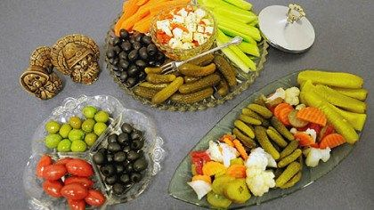Relish trays An assortment of trays. Clockwise, from top, an Anchor Hocking tray from the 1960s, stocked with black olives, sweet gherkins, ...