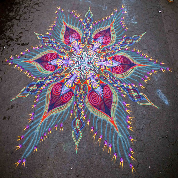 This bold design was created using colored sand by artist Joe Mangrum. The art resembles traditional Buddhist mandalas with inspiration from marine life.