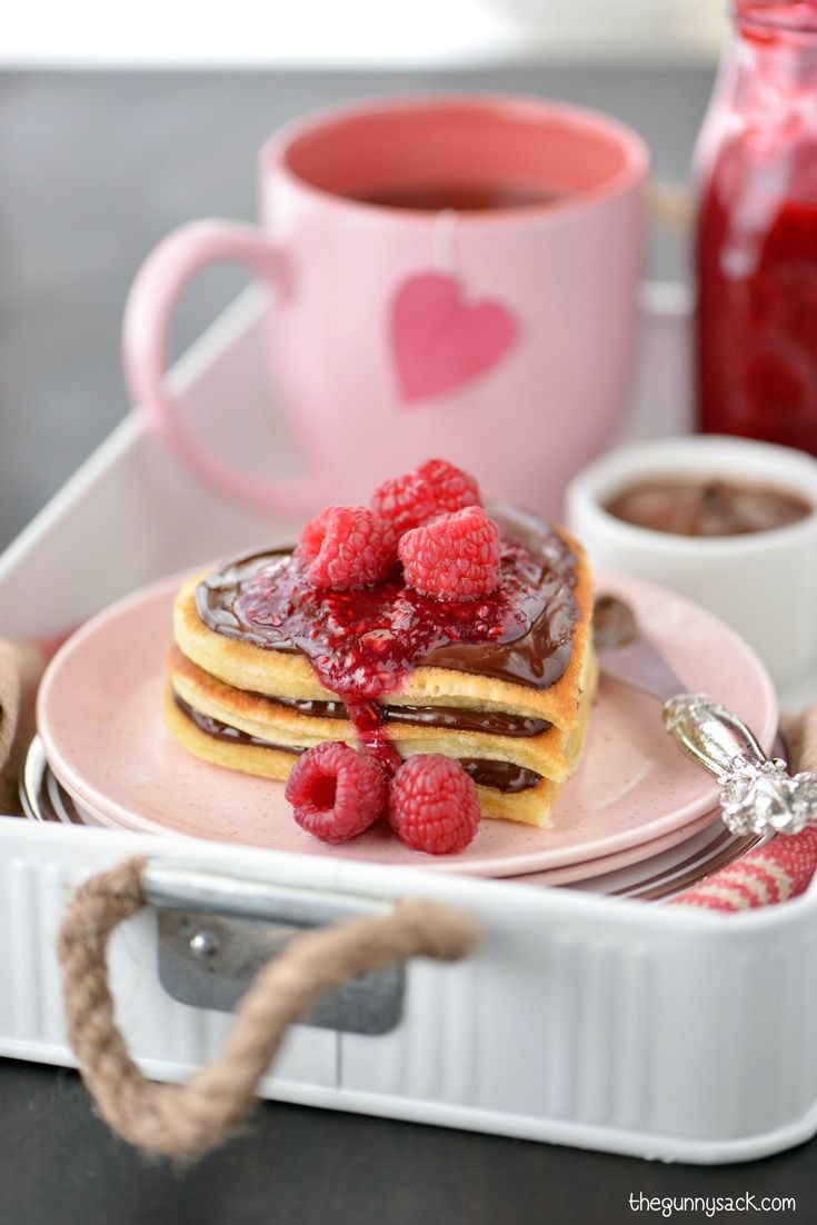 Make this heart shaped buttermilk pancake recipe for a delicious breakfast in bed! They are extra special when topped with Nutella and raspberry sauce.