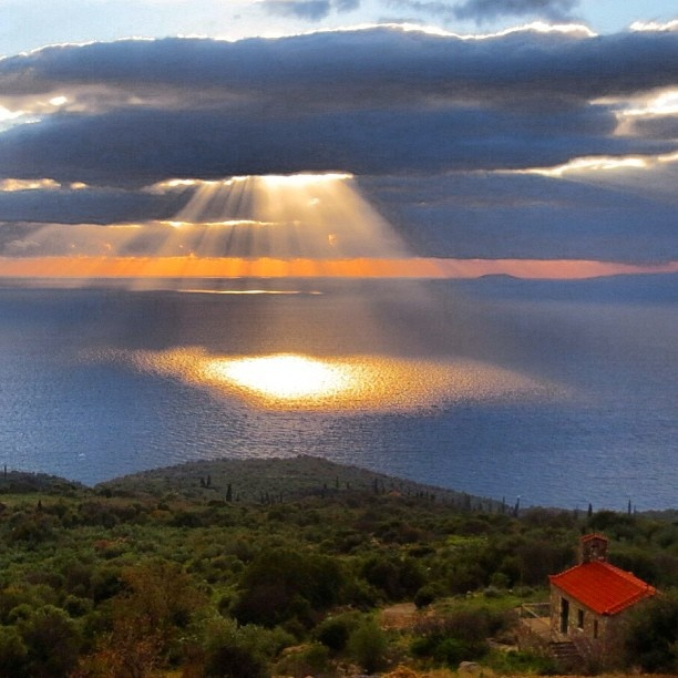 Today's sunset as viewed from the village of Platsa, Mani, Greece. It looked like heaven was communicating with the little church you can see on the right hand side of the picture. #Padgram
