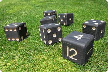 Lawn dice can be played outside on grass or inside on carpet.