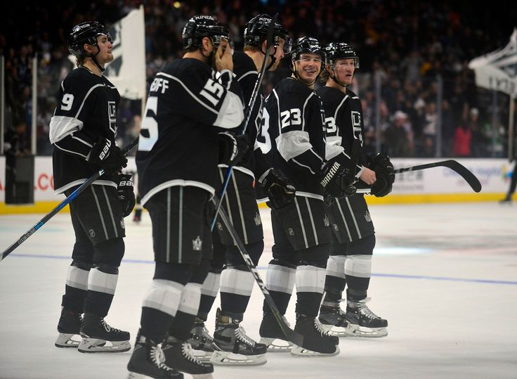 Dustin Brown ends 1000th career game with overtime goal