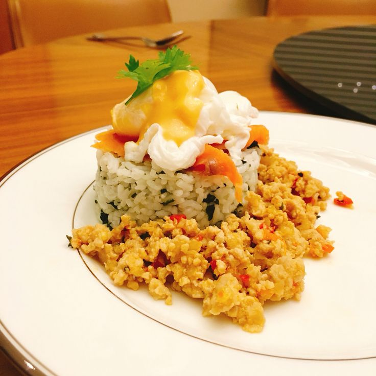 Rice egg benedict with thai chilli basil chicken.   Recipes in www.instagram.com/p/BGEulMDEGi3/?taken-by=tiarvafilin