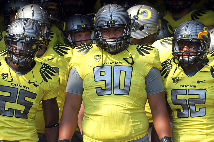 Sept. 10 vs. Nevada: Ricky Heimuli led the Ducks out of the tunnel in a yellow jersey, carbon fiber helmet, steel pants, black socks and yellow shoes.