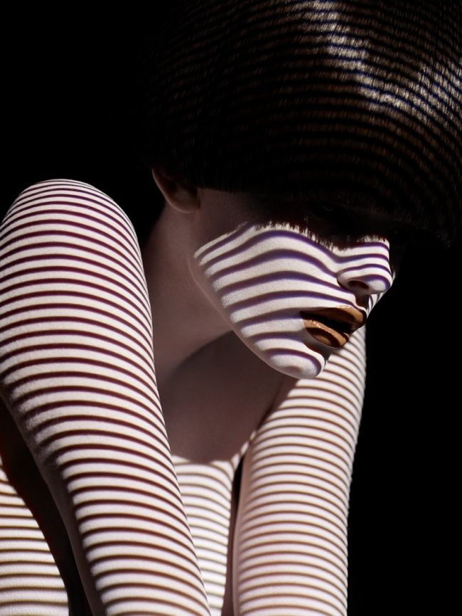 15 outstanding photographs of models clothed only in light and shadow