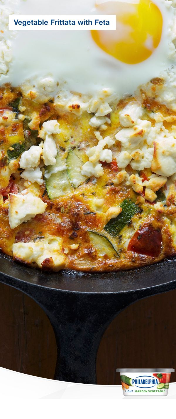 Wake up your breakfast hour with a savoury frittata made with zucchini, red pepper, Cracker Barrel® Crumbled Feta Cheese, and Philadelphia® Garden Vegetable Light Cream Cheese. It's incredibly tasty and easy to make, even before you've had your coffee.