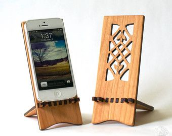 Enjoy introducing the natural feel of wood to your electronic world.    This stand is a perfect companion at home, work, and your local coffee shop. The stand is adjustable, perfect for travel. One setting is ideal for typing, the other makes movie watching a joy.    My ideas in wood are made with solid cherry wood respectfully harvested from Pennsylvanias rich forests.    5.75 inches wide  8 inches from the tray to the top  8.75 inches from the feet to the top  The back foot insert is 5…