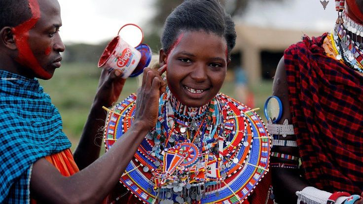 Joyce Tokoyan, a Maasai female athlete, has her face smeared with red ocher paint during preparations for the 2016 Maasai Olympics at the Sidai Oleng Wildlife Sanctuary, at the base of Mt. Kilimanjaro, near the Kenya-Tanzania border in Kimana, Kajiado, Kenya December 10, 2016.